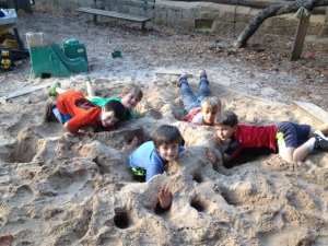 After School children show off their tunnel-building skills during free play.